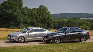 Audi A5 Sportback 3.0 TFSI, BMW 335i GT, Seitenansicht