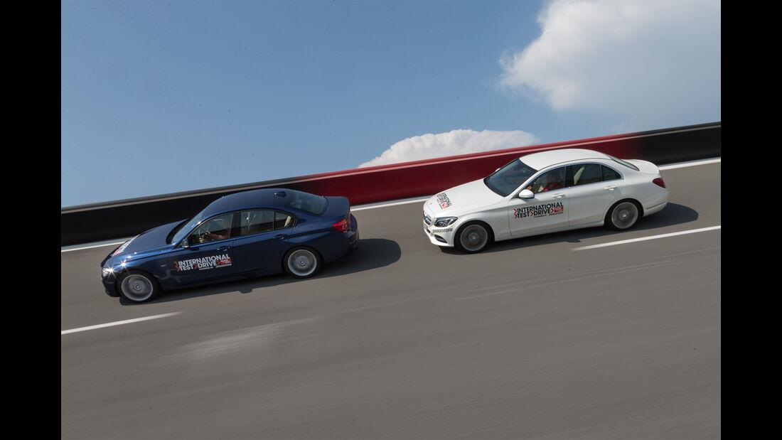 BMW 340i, Mercedes C400 4Matic, Seitenansicht