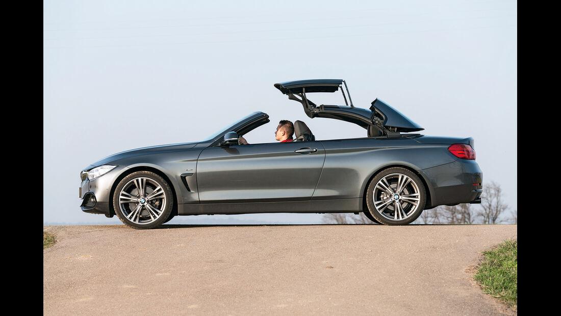 BMW 428i Cabrio Sport Line, Seitenansicht, Verdeck öffnet