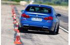 BMW M5 Competition, Heckansicht, Slalom