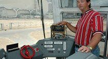 Bob Myers, a crawler systems engineer with United Space Alliance, stands beside the driver's console inside a Crawler-Transporter cab. Credit: NASA/KSC