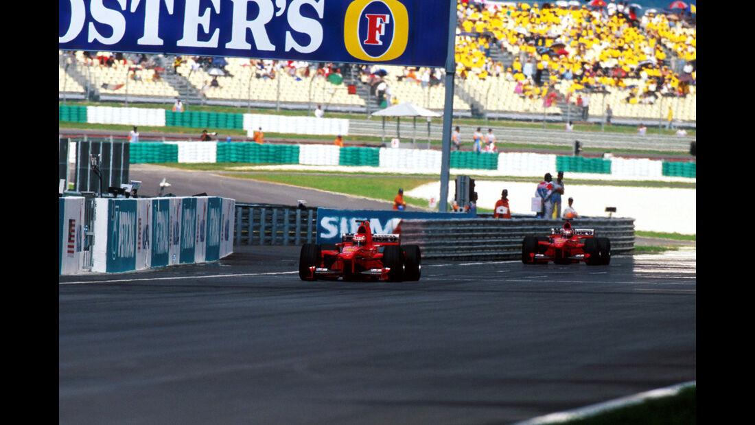Eddie Irvine - Michael Schumacher - Ferrari - GP Malaysia 1999