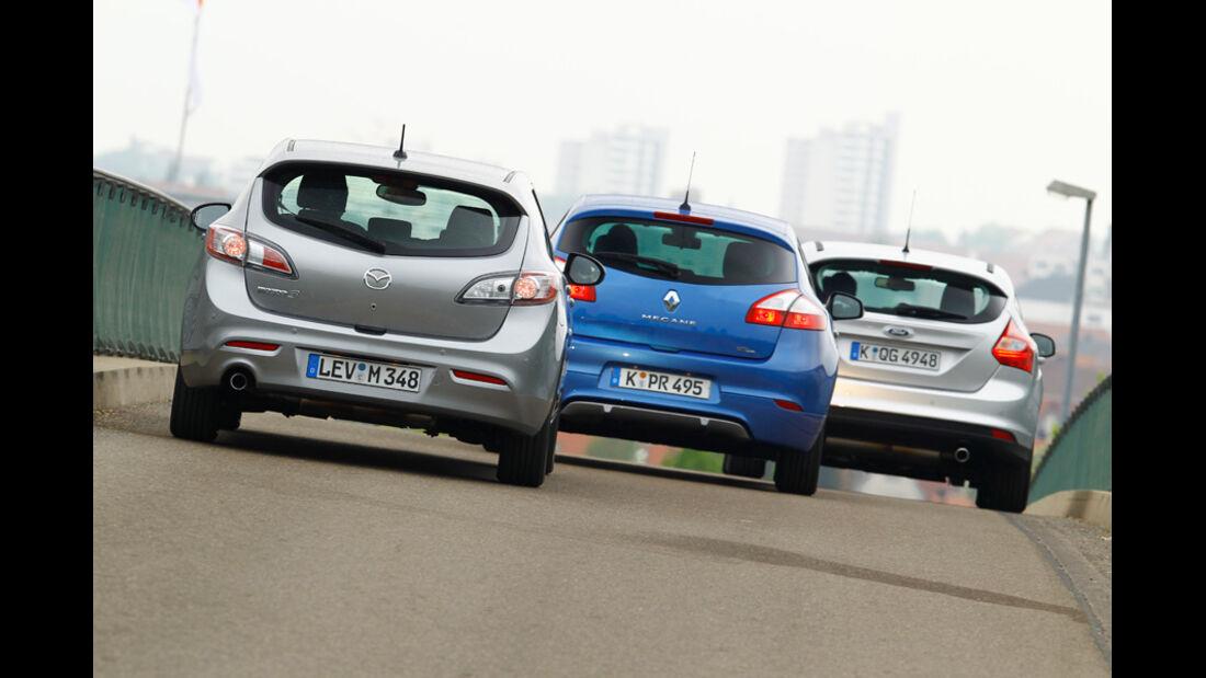 Ford Focus 1.6 ECOBOOST, Mazda 3 2.0 MZR i-STOP, Renault Megane TCe 130, alle Fahrzeuge, Rückansicht
