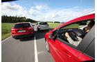 Ford Focus Turnier 1.6 Ecoboost Titanium, Opel Astra Sp.Tourer 1.4 Turbo Innovation, Peugot 308 SW 155 THP Allure, Heckansicht, Fahrt