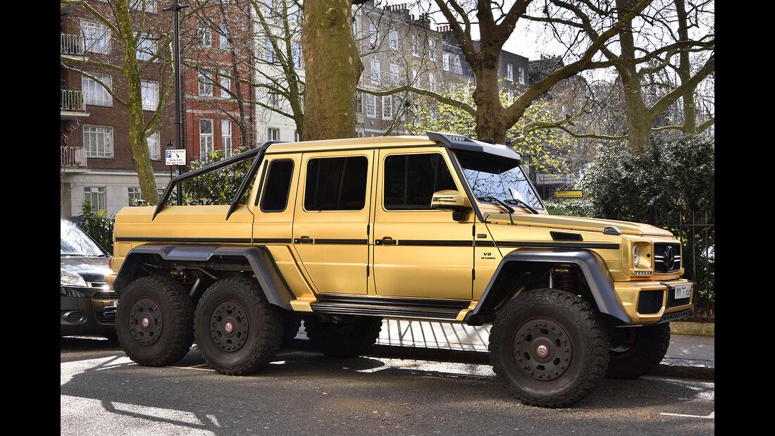 Golden supercars in Kensington