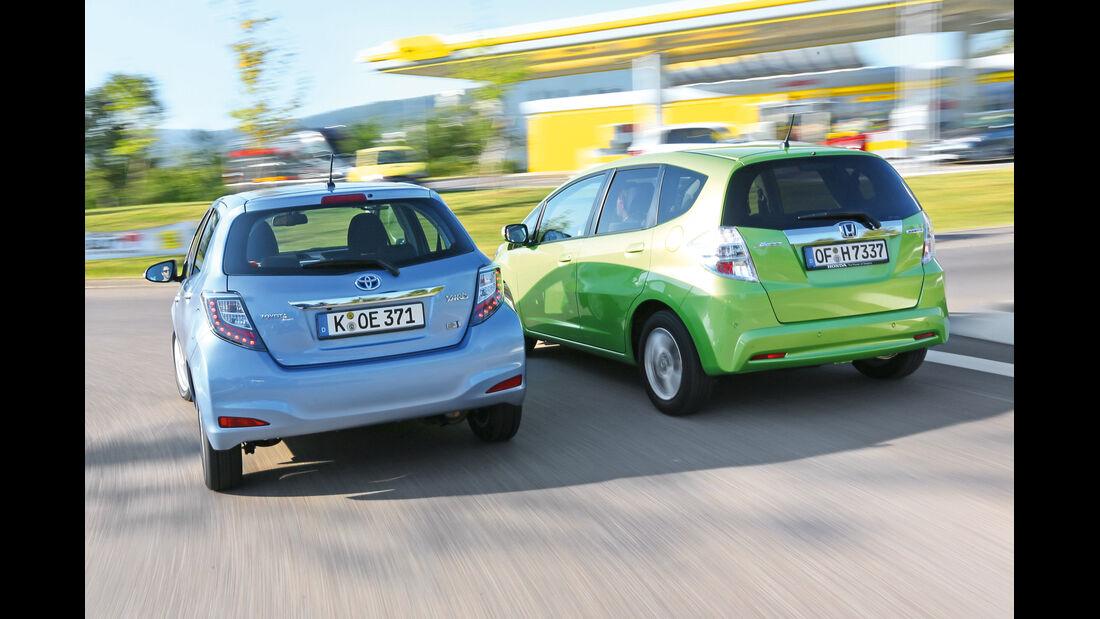 Honda Jazz 1.3 DSi i-VTEC IMA Exclusive, Toyota Yaris 1.5 VVT-i Hybrid Life, Heckansicht