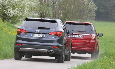 Hyundai Santa Fe 2.2 CR Di 4WD, Land Rover Freelander 2.2 SD4, Heckansicht