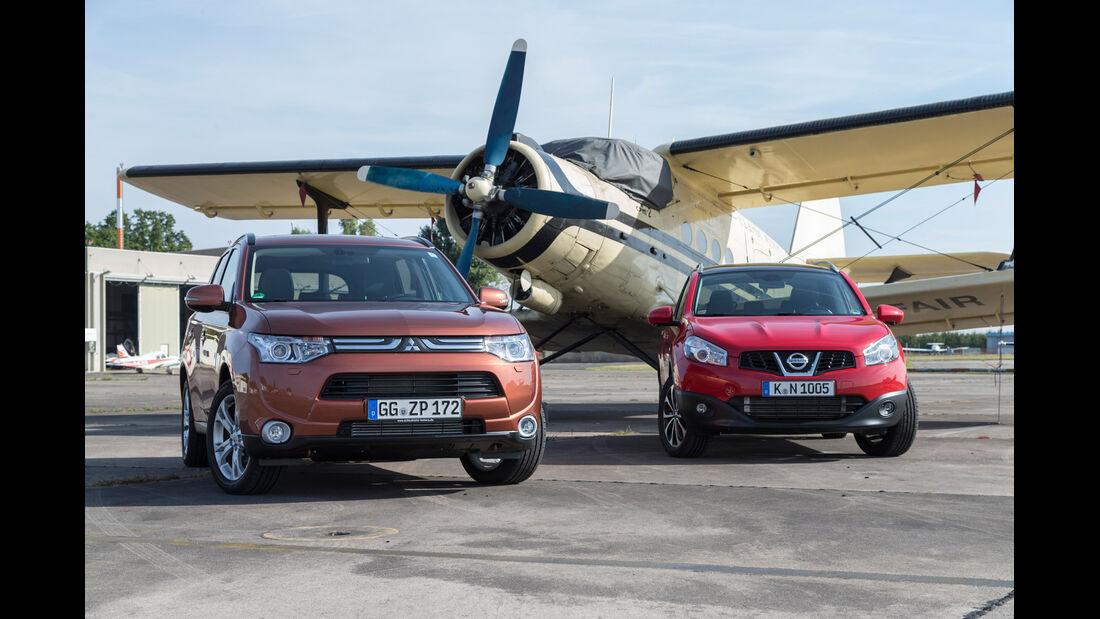 Mitsubishi Outlander 2.2 Di-D 4W, Nissan Qashqai +2 2.0 dCi, Frontansicht