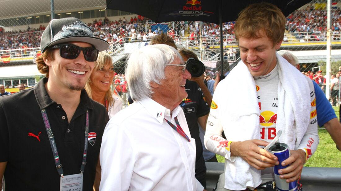 Nicky Hayden, Bernie Ecclestone und Sebastian Vettel