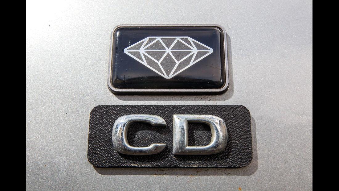 Opel Omega A Caravan, Emblem, Typenbezeichnung