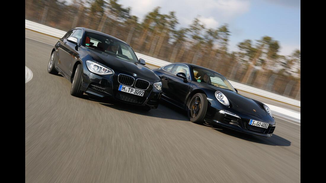 Porsche 911 Carrera 4, BMW M135i xDrive, Frontansicht