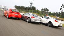 Porsche Cayman S, Audi TT RS, Nissan 370Z Nismo, Heckansicht