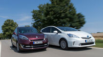 Renault Gr. Scénic 1.5 dCi Dynam., Toyota Prius Plus Life, Frontansicht